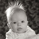 crazy hair baby studio portrait by Dinan Photo, a Beleville IL photographer